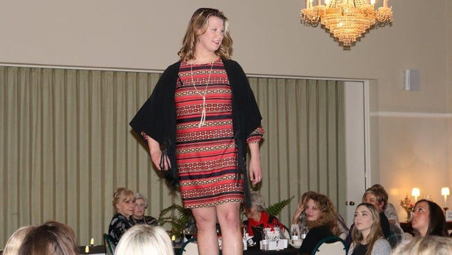"""Dr. Samantha Hirsch Goodman shows off fashions at the Community Foundation of Abilene's recent """"A Perfect Fit for Giving"""" Style Show."""