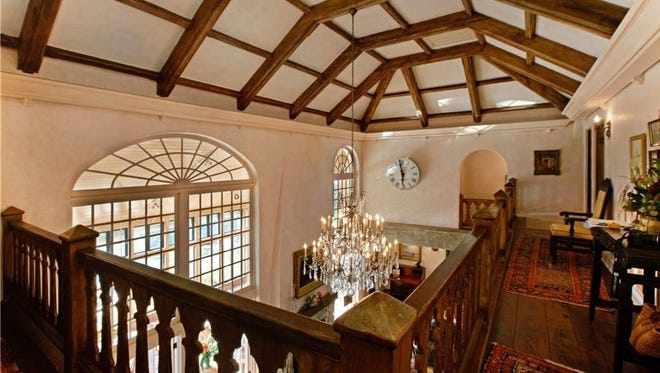 The mezzanine gives you a bird's eye view of grand living hall with its 22-footceiling in this Sewall's Point mansion