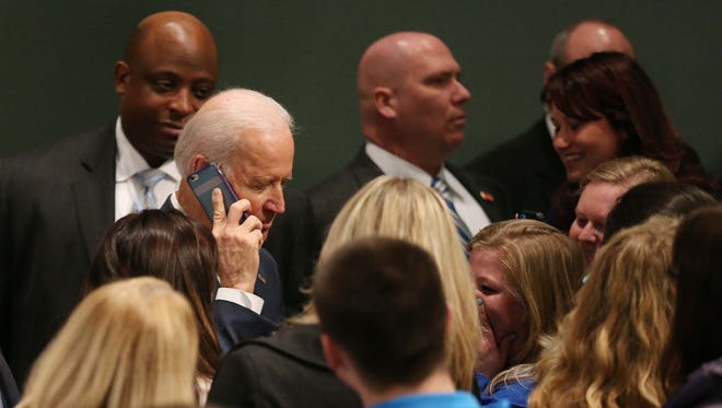 Vice President Joe Biden talks on Drake student Kayla Day's phone, he left a voicemail for Day's mom after she told Biden her mother would not believe she got to talk to the Vice President on Thursday, Feb. 12, 2015 in the Sheslow Auditorium at Drake University.