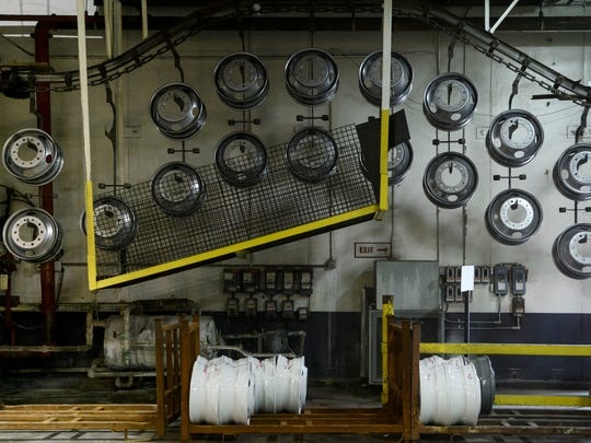 New steel wheels travel along the production floor at the Accuride facility in Henderson, Ky., Thursday, April 26, 2018. More than 10,000 wheels, which are used in the commercial trucking industry, are produced daily at the Henderson plant.