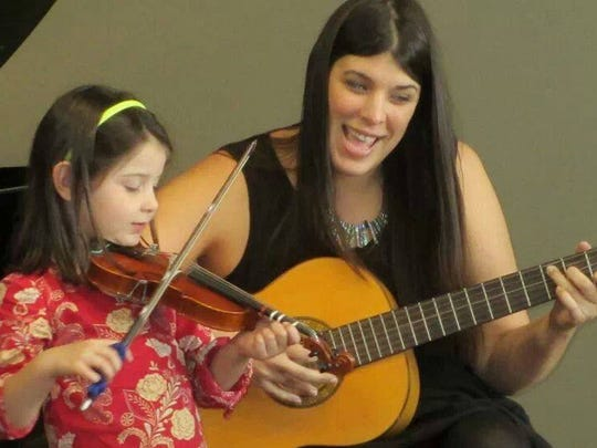 """Katie Roche and her daughter, Stella Roux, rehearsing """"The Fall Song"""" together."""