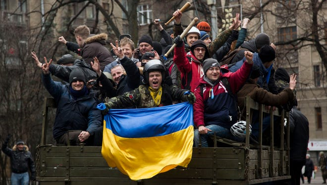 Protesters celebrate as they ride atop a truck in central Kiev, Ukraine, on Feb. 22.