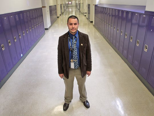 Jo?l Mu?oz, assistant principal at IPS Washington Community High School, stands in the hallway, Friday, May 2, 2014.