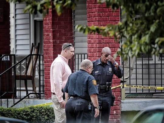 On Sept. 26, 2015, police continued to investigate the scene of a triple homicide on Lake Grove near Chelsea where three people were found shot to death.