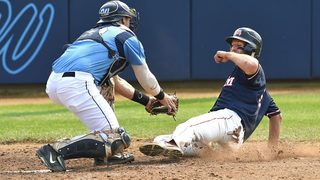 Watkins catcher Brendan Ashton tags out New Market's Nick Rost as he tries to score in the third inning Saturday during the state amateur baseball tournament in Watkins.