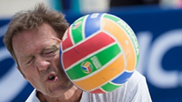 """An unidentified player takes a shot from """"The Kerri Cannon,"""" a virtually controlled game event based on Kerri Walsh Jennings' famed spike."""