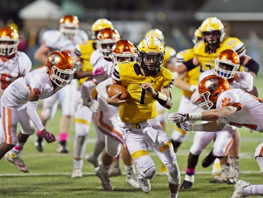 Red Lion quarterback Zach Throne keeps the ball against