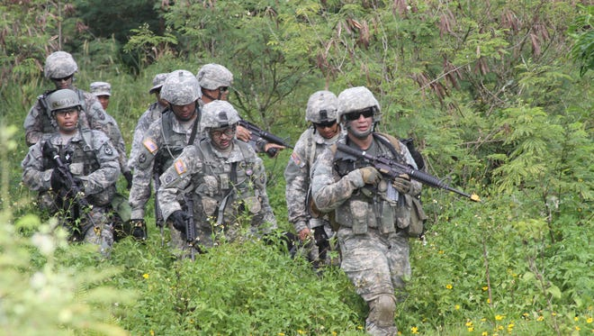 Soldiers with the Guam Army National Guard's 203rd Regional Training Institute conduct exercises during unit training activities.