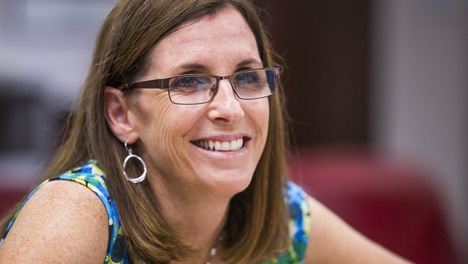 Rep. Martha McSally, R-Ariz, meets with Terry Rozema, police chief of the Town of Marana, in her offices in Tucson,  Monday, August 21, 2017.