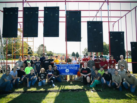 These students from the Coshocton County Career Center's metal fabrication and construction technology programs helped expand this obstacle, originally featured in the local Indian Mud Run, for use in the OCR World Championships in Ontario, Canada, Friday through Sunday.