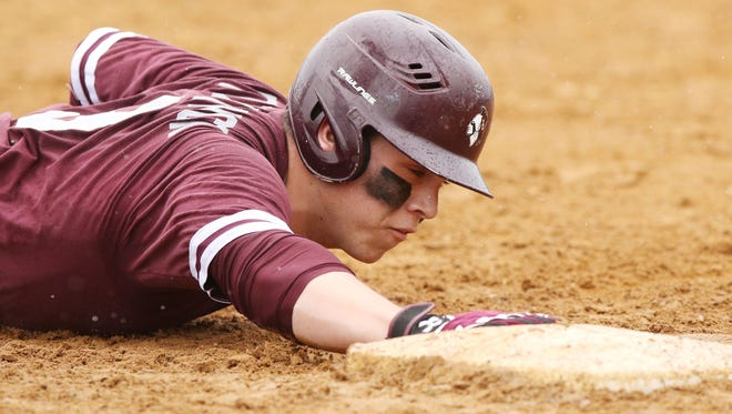 Toms River South's Matt Fitzpatrick is shown sliding back to first base in the Indians' game at Toms River North on April 17. Toms River South is ranked No. 1 in the Asbury Park Press Baseball Top 10 for the third straight week.