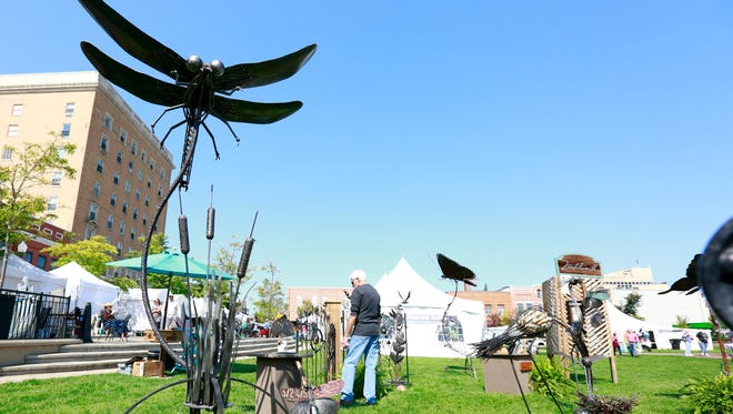 A large dragonfly metal sculpture displays for sale during Sunday's Artrageous event at The 400 Block in downtown Wausau.