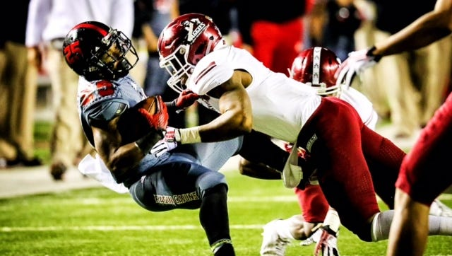 UL's Torrey Pierce is tackled after gaining yardage for a first down against New Mexico State.