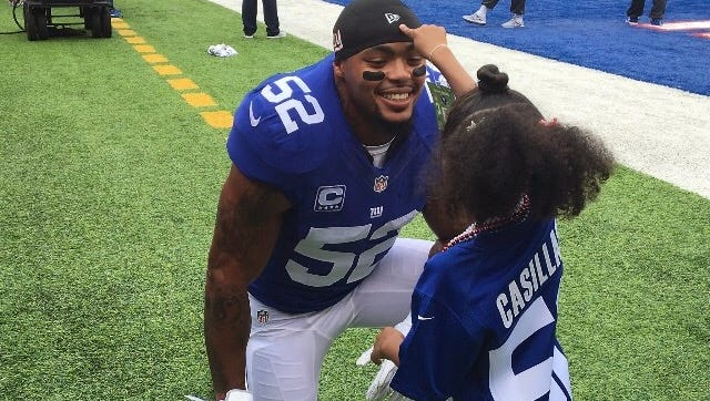 Giants defensive captain and linebacker Jonathan Casillas spends a moment with his 5-year-old daughter Jade prior to a game last season at MetLife Stadium in East Rutherford.