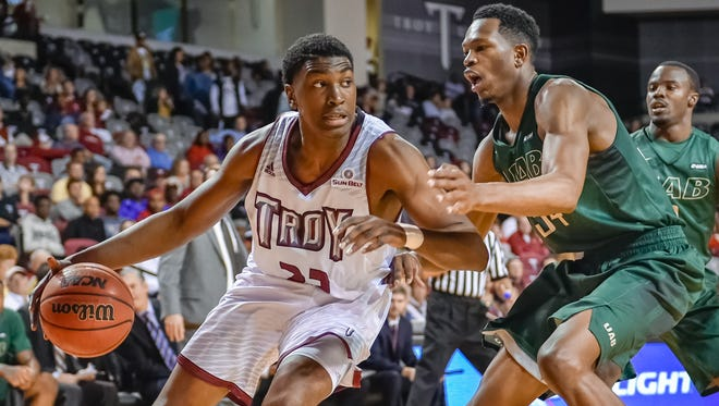 Troy's Jordon Varnado drives on UAB's William Lee in Thursday's game at Trojan Arena. The Blazers won 79-63.
