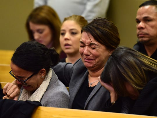 """center, Sonia Torres, the wife of Joseph """"Joey"""" Torres, is flanked by her daughters after he was sentenced to five years of prison time for his role in a corruption scandal during his time a Paterson mayor before Hudson County Superior Court Judge Sheila Ann Venable Tuesday morning."""