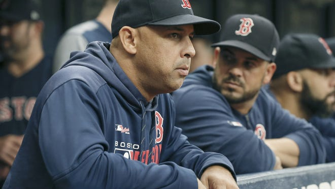 Red Sox manager Alex Cora looks on from the bench during the first inning against the Tampa Bay Rays at Tropicana Field.