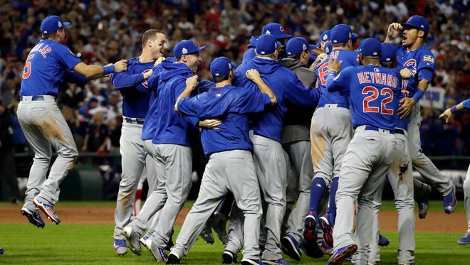 The Chicago Cubs celebrate after Game 7 of the Major League Baseball World Series against the Cleveland Indians Thursday, Nov. 3, 2016, in Cleveland. The Cubs won 8-7 in 10 innings to win the series 4-3.