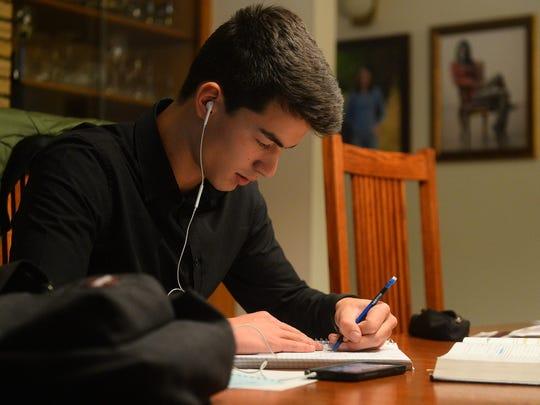 Hugo Richard completes math homework Tuesday evening