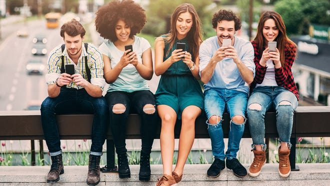 Are electronic devices and shifting cultural norms making it more difficult for kids to embrace adulthood?