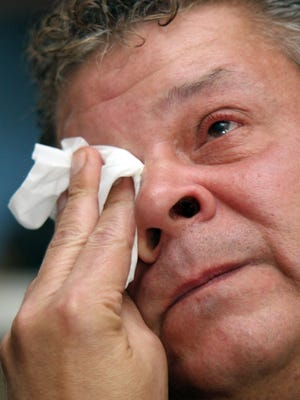 "Edward ""Don"" Godawa of Elsmere wipes away tears as he talks about the death of his son, Michael Godawa, 21, who was shot and killed by an Elsmere police officer during a traffic stop in 2012. A civil suit filed in the case that had been dismissed has been reinstated by a three-judge panel."