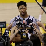 In this April 17, 2015, file photo, the New Orleans Pelicans' Anthony Davis speaks with the media during NBA basketball practice in Oakland, Calif. Davis sounds rather pleased that the New Orleans Pelicans have done virtually no tweaking to their roster since their first-round exit from last season's playoffs.Rather, it was the promise of roster stability, combined with the introduction of a new, fun-loving coach with an up-tempo scheme, which made him eager to commit long-term to New Orleans.