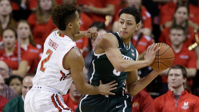 Michigan State guard Bryn Forbes, right, keeps the ball away from Maryland guard Melo Trimble in the second half Saturday in College Park.
