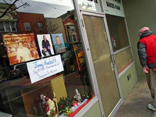 "A memorial to Jimmy Hackett, using his slogan ""super good,"" is posted on the window of Leo & Jimmy's Delicatessen on North Market Street in Wilmington on Monday. Hackett died Friday."