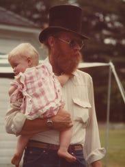 Gary 'Bonz' Saddlemire holds his daughter, Erin Saddlemire