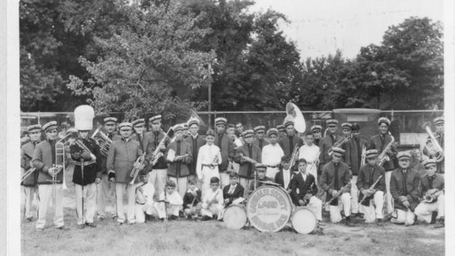 Italian band the Giuseppe Garibaldi Society of Monroe posed for a photo around 1931. The band was started by Sebastian Germani (shown fifth from left) and played at parades and venues across the area for years. It took part in an annual all-day celebration for St. Virsine Adolorata del Romi Tello.