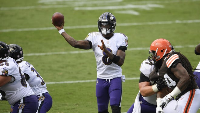 Baltimore Ravens quarterback Lamar Jackson (8) looks to pass during the second half against the Cleveland Browns, Sunday, Sept. 13, 2020, in Baltimore.