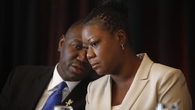 Sybrina Fulton, mother of Trayvon Martin, listens to her lawyer, Benjamin Crump, during a   press conference in July.