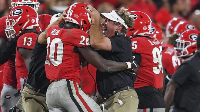 Sep 21, 2019; Athens, GA, USA; Georgia Bulldogs defensive back J.R. Reed (20) reacts with head coach Kirby Smart reacts after intercepting a pass against the  Notre Dame Fighting Irish during the second half at Sanford Stadium. Mandatory Credit: Dale Zanine-USA TODAY Sports ORG XMIT: USATSI-404019 ORIG FILE ID:  20190921_gma_sz2_464.jpg