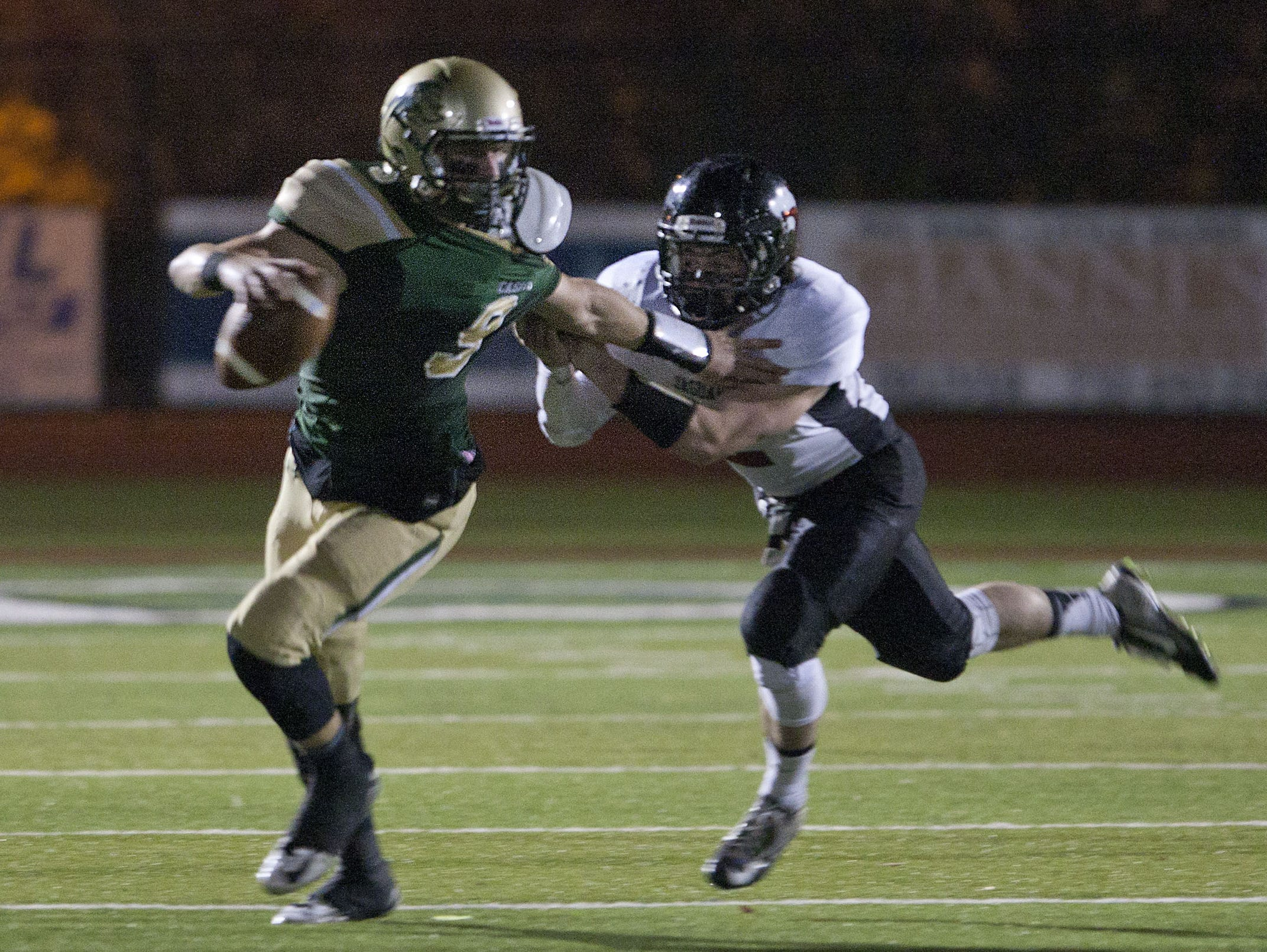 Red Bank Catholic senior quarterback Eddie Hahn, shown being pursued by a Jackson Memorial defender on Nov. 6, and the Caseys, will play at St. John Vianney Friday night in a NJSIAA Non-Public GroupI III semifinal.
