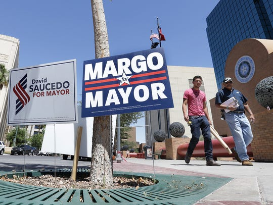 Only a few campaign signs can be seen throughout town