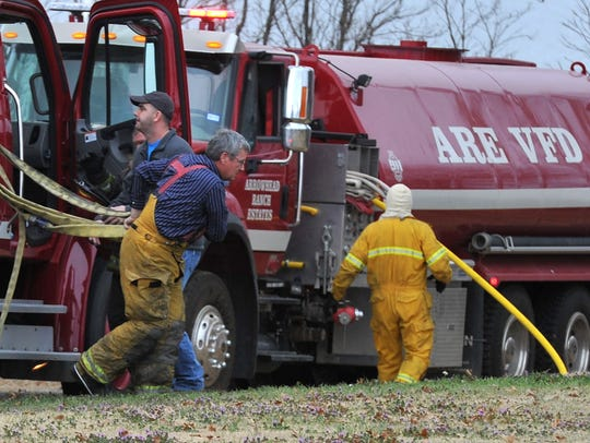 In this file photo, local and area firefighters work to contain a house fire on West Arrowhead Drive at Lake Arrowhead in Clay County. The city of Wichita Falls owns property at both Arrowhead and Kickapoo and leases it to residents. Law enforcement services are provided by Archer or Clay counties and each lake has a volunteer fire department.