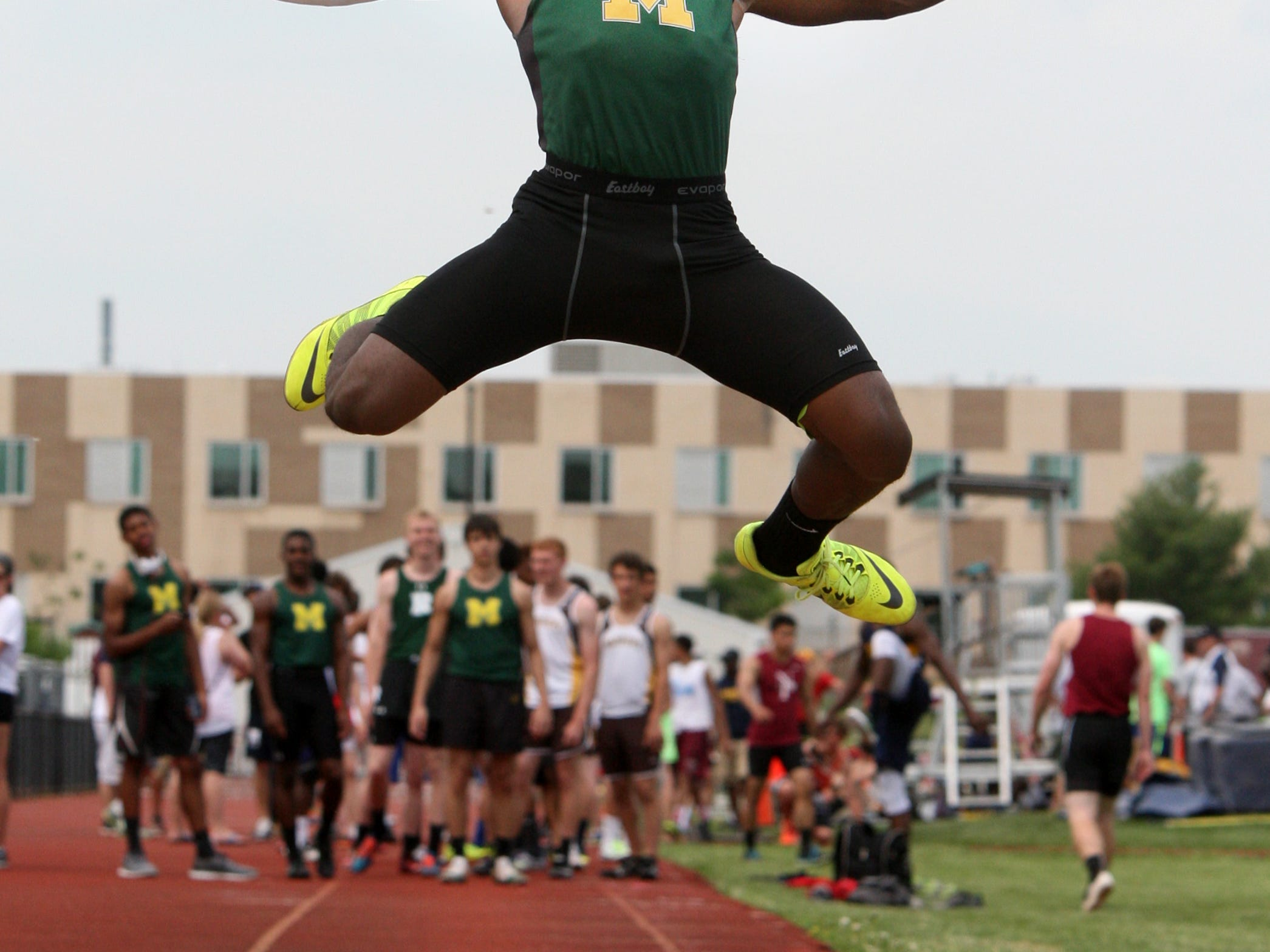 The 2015 Somerset County Track and Field Championships held at Hillsborough High School on Tuesday May 12,2015. Montgomery's Patrick Warren competes during the Boys Long Jump.