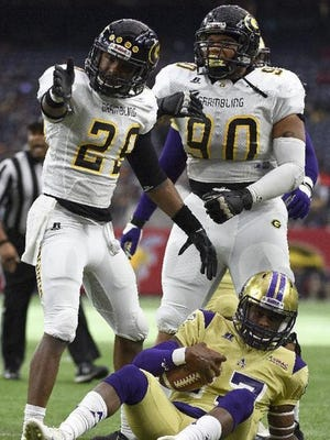 Grambling State defensive back Guy Stallworth (29) celebrates his tackle of Alcorn State quarterback Lenorris Footman (17) in the 2015 SWAC Championship game in Houston.