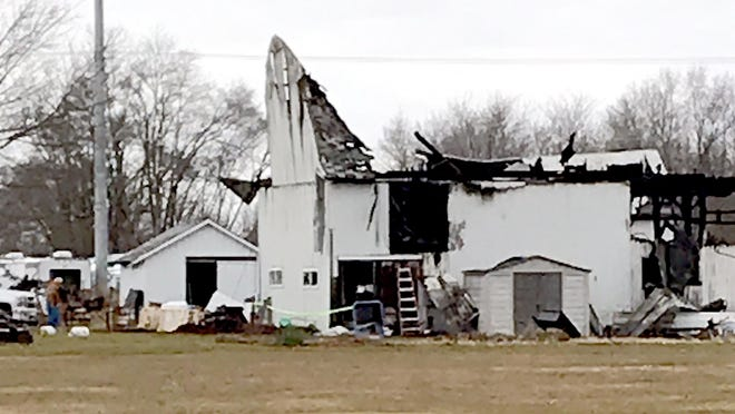 This barn at Jerry Kash Inc. in White Pigeon is deemed a total loss after a fire early Wednesday. Fire crews were able to save the first floor and its contents.