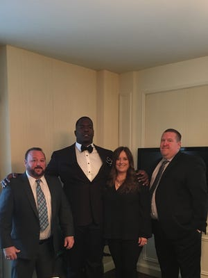 Former Louisiana Tech defensive tackle Vernon Butler, second from left, is pictured with members of his ProSource Sports Management team at the NFL Draft. From left, Jeff Guerriero, Liz Guerriero and Rick Roberts.