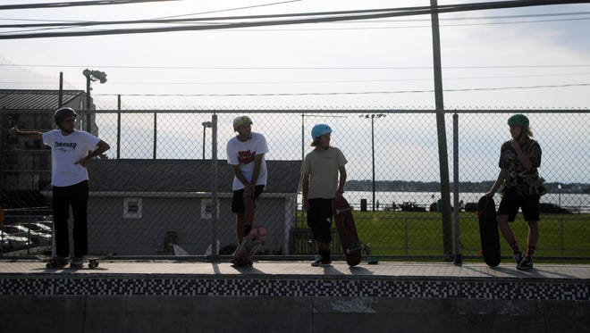 Skaters line the outside of the Ocean Bowl in Ocean City waiting for their turn.