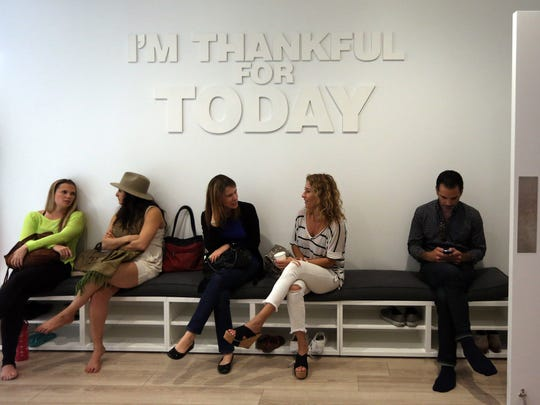Meditation is now shared by millions, like those at the Unplug studio.