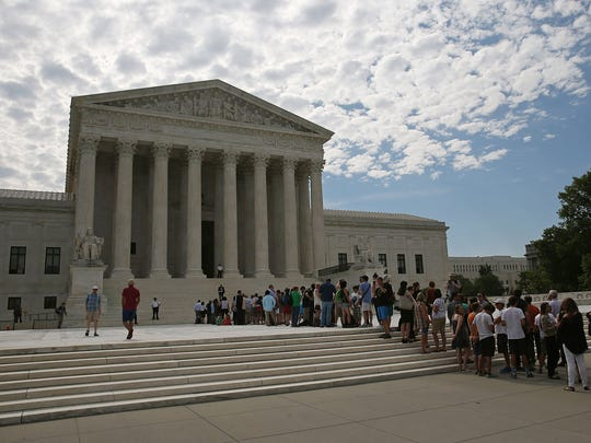 People wait in line to enter the U.S. Supreme Court