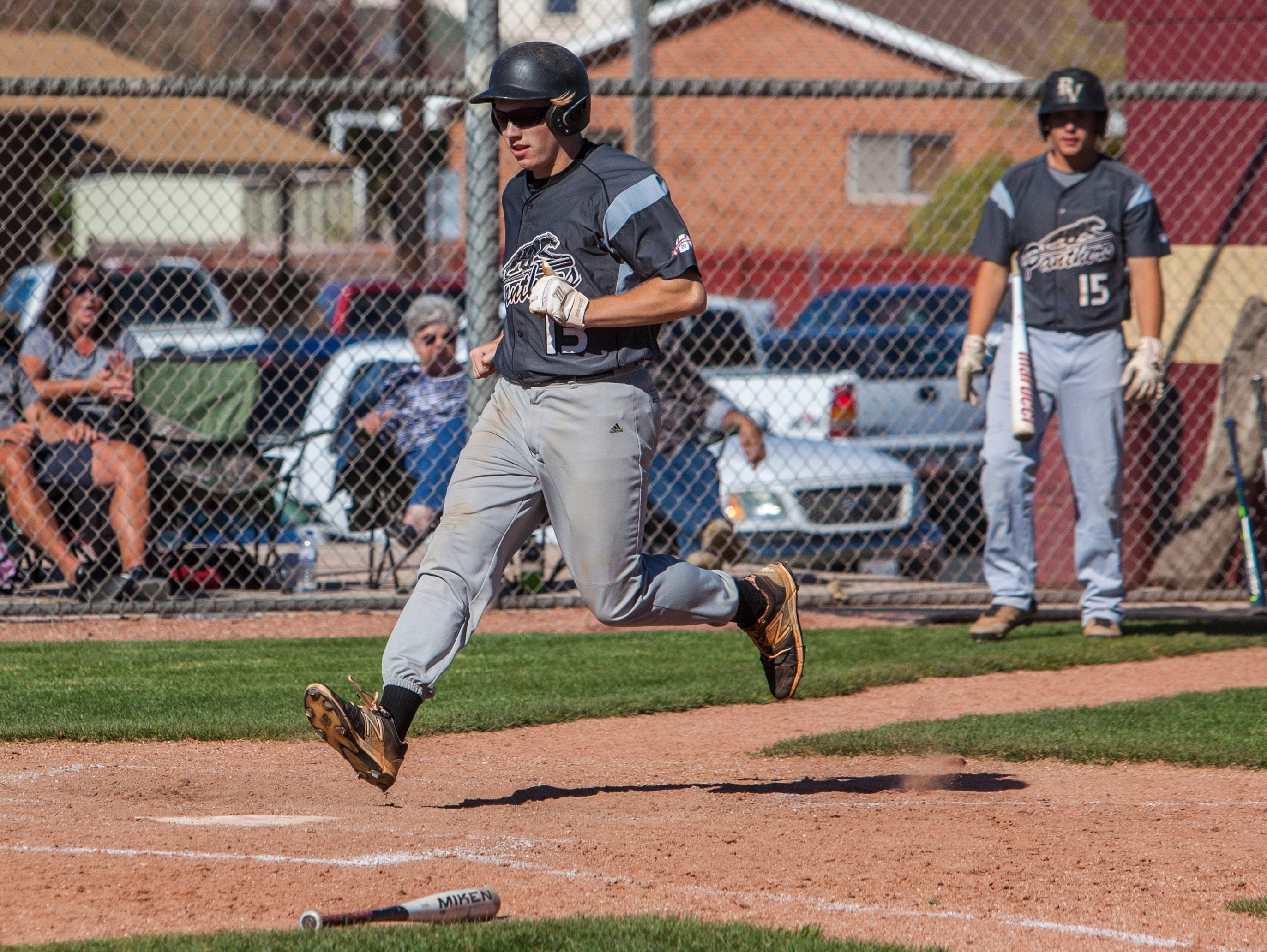 Pine View's Jared Striling crosses home plate for a score during the game against Cedar, Tuesday, April 19, 2016.