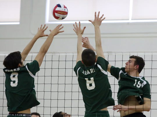 Old Bridge High School takes onEAst Brunswick High School in a boys varsity volleyball game in East Brunswick on Tuesday April 26, 2016.St Joseph's # 19 (right) Nicholas DiMarzio gets the ball between East Brunswick's # 9 Kyle Loesner (left) and # 8 Ben Harrop (center)