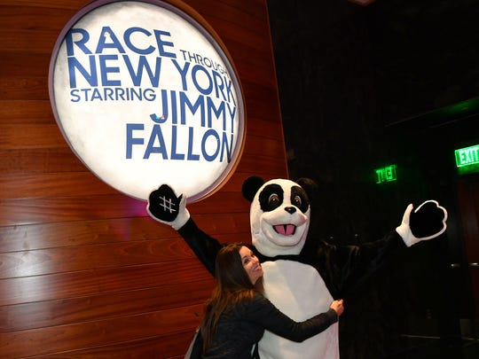 Hashtag the Panda poses with attendees of the media