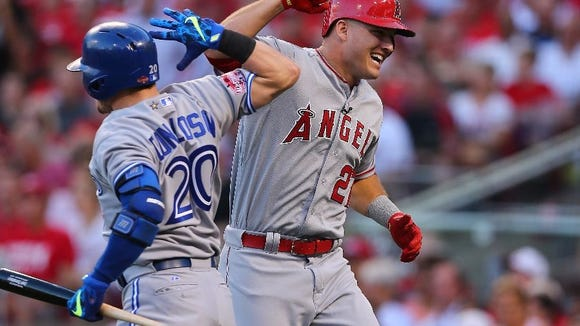 MVP Mike Trout celebrates his leadoff homer.