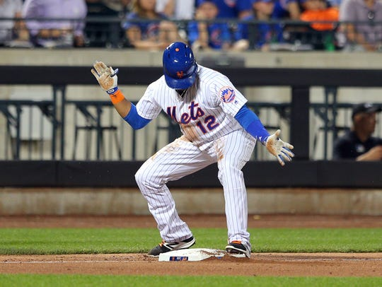 Mets center fielder Juan Lagares (12) reacts after