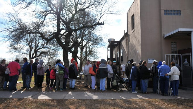 The line for the annual Thanksgiving Dinner at the Christian Soup Ministry in Hutchinson was down the sidewalk as people awaited the meal in 2015. The meal is scheduled to be served starting noon Wednesday as a drive-through pickup. Participants must be present to receive a meal.