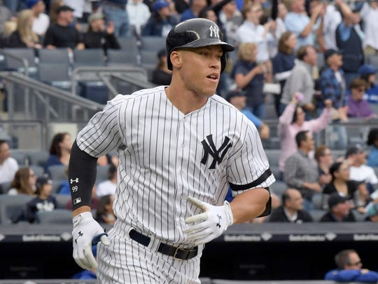 New York Yankees' Aaron Judge rounds the bases with